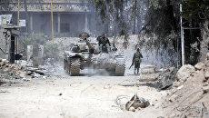 Солдаты Сирийской армии на восточной окраине Думы. Архивное фото