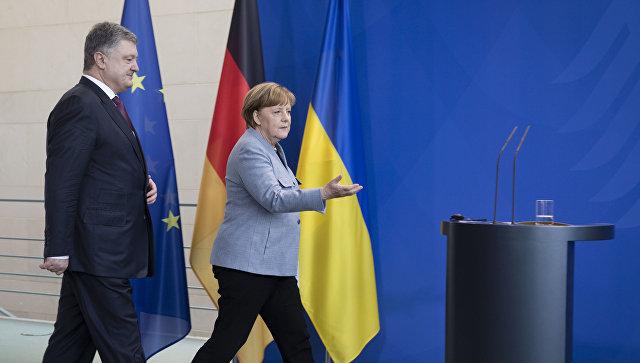 Президент Украины Петр Порошенко и канцлер Германии Ангела Меркель во время совместной пресс-конференции по итогам встречи в Берлине. 10 апреля 2018