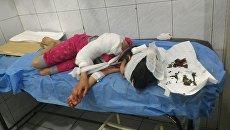 Дети получившие осколочные ранения при обстреле жилого квартала Алеппо. 6 мая 2018