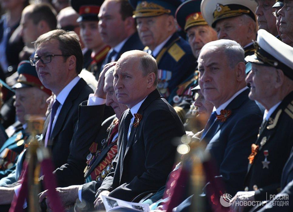 Президент России Владимир Путин во время военного парада в ознаменование 73-й годовщины Победы в Великой Отечественной войне 1941–1945 годов на Красной площади в Москве. 9 мая 2018