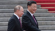 Президент РФ Владимир Путин и председатель КНР Си Цзиньпин во время встречи в Пекине