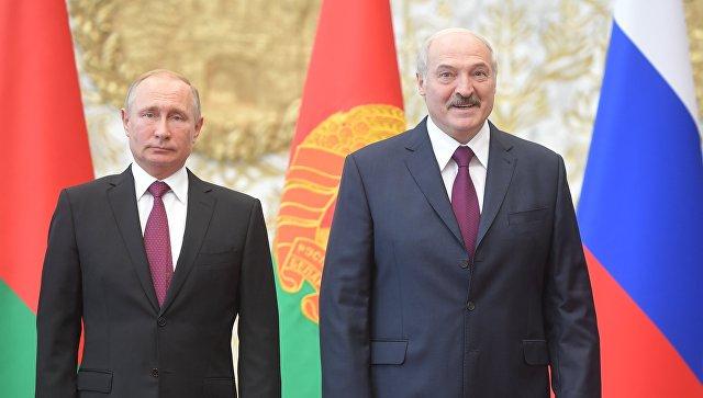 Президент РФ Владимир Путин и президент Белоруссии Александр Лукашенко перед заседанием Высшего Государственного Совета Союзного государства во Дворце независимости в Минске. 19 июня 2018
