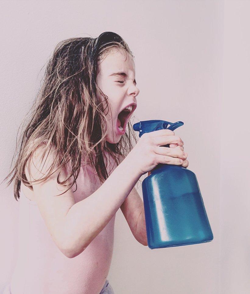 Работа фотографа Melisa Barrilli из Каанды Spray Fury, занявшая первое место в категории Дети в фотоконкурсе 2018 iPhone Photography Awards