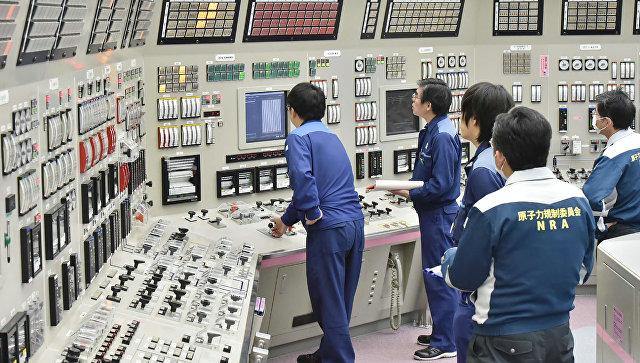 Сотрудники АЭС в Японии. Архивное фото