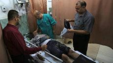 Раненый в результате израильских авиаударов палестинец в больнице в южной части сектора Газа. 17 октября 2018