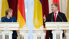 Президент Украины Петр Порошенко и канцлер Германии Ангела Меркель во время встречи. 1 ноября 2018