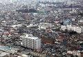 Вид на пострадавший в релуьтате землетрясения город Сендай, префектура Мияги