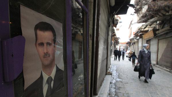 Прохожие на улицах сирийской столицы