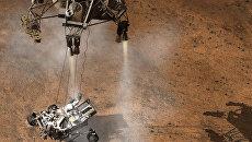Небесный кран опускает марсоход Curiosity на поверхность Марса, архивное фото
