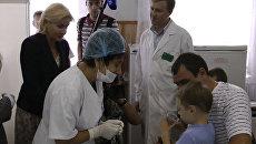 Вице-премьер Голодец уговорила мальчика в Крымске выпить лекарство