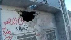 Последствия артобстрела в Сирии, при котором погибли более 100 человек
