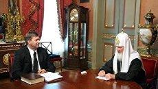 Отредактированная фотография со встречи Патриарха Кирилла с министром юстиции Коноваловым