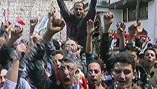 Сторонники президента Сирии устроили массовое шествие в Дамаске