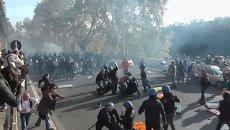 Полицейские газом и дубинками разгоняли протестующих в городах Европы
