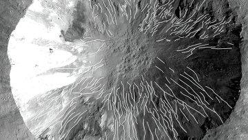 Прямые и извилистые овраги в кратере Корнелия на Весте (обозначены белыми линиями), снимок зонда Dawn