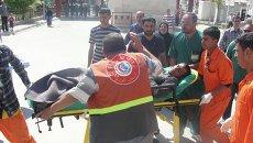 Пострадавший во время столкновений демонстрантов с силами безопасности в иракском городе Киркук
