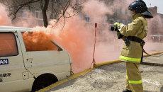 Тренировка добровольной женской пожарной дружины во Владивостоке