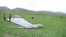 Первые кадры с места крушения самолета ВВС США в Киргизии