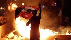 Участник демонстрации в Анкаре, Турция
