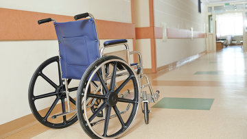 Инвалидное кресло. Архивное фото
