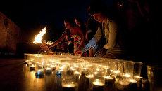 Томичи зажгли свечи в День памяти и скорби