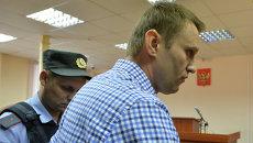 Навальный приговорен к пяти годам колонии