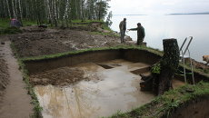 Археологи на раскопках в Новосибирской области