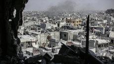 Вид с высотного здания на улицы в центре Хомса. Архивное фото