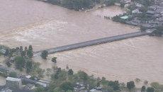 Потоки воды захлестнули поселки в Японии из-за тайфуна Ман-И