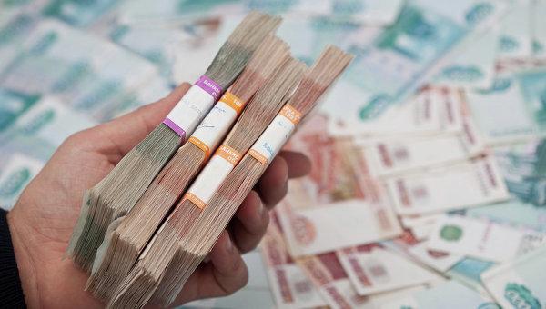 Пачки денег. Архивное фото