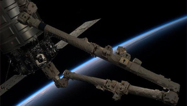 Стыковка корабля Cygnus с МКС. Архивное фото