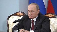 Путин назвал митинги в Киеве погромами с участием боевиков