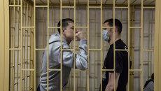 Подсудимые по делу приморских партизан Владимир Илютиков и Роман Савченко. Архивное фото