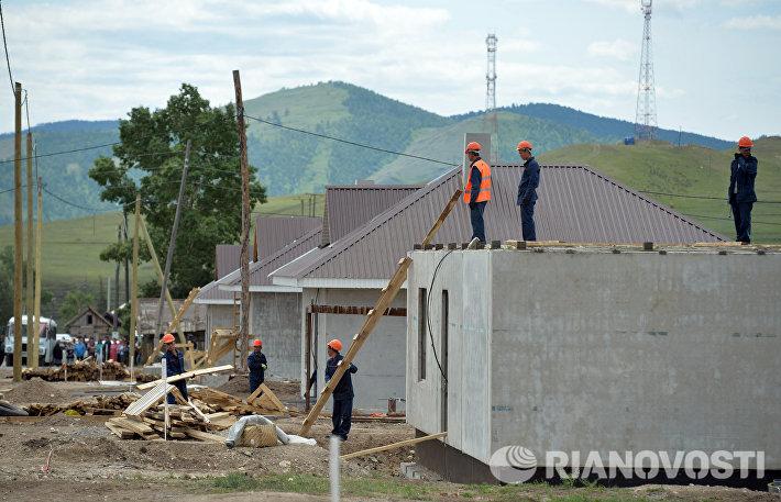 Строительство домов для пострадавших от пожаров жителей села Усть-Бюр в Хакасии